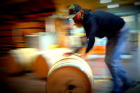 Lee rolling full barrel of whiskey