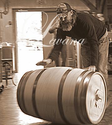 Lee rolling full barrel of whiskey